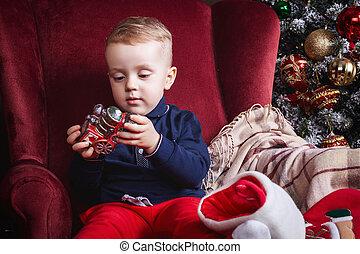 little boy holding a toy train