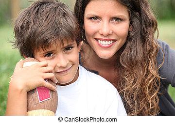 Little boy holding American football