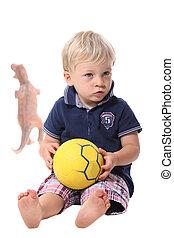 Little boy holding ball isolated on white background