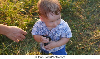 little boy holding car keys and play them