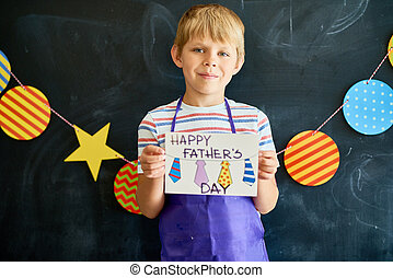 Little Boy Holding Gift Card for Fathers Day