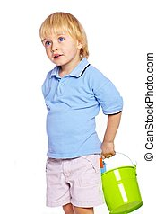 Little boy holding green bucket
