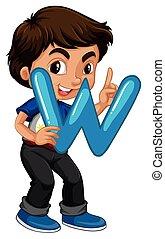 Little boy holding letter W