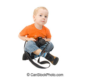 little boy holding photocamera