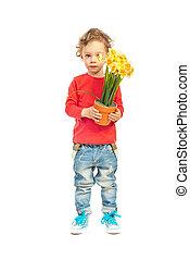 Little boy holding pot of daffodils