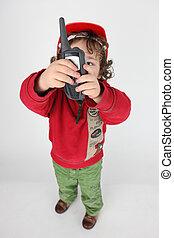 Little boy holding radio-receiver