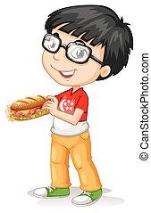 Little boy holding sandwiches