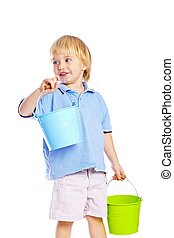 Little boy holding two buckets