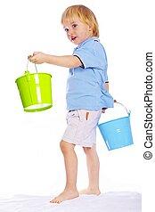 Little boy holding two buckets