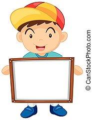 Little boy holding white board