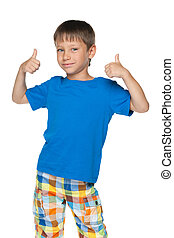 Little boy holds his thumbs up