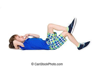 Little boy imagines on the floor