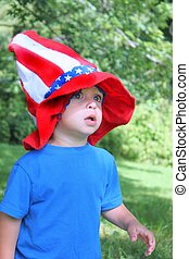 Little boy in 4th of July hat