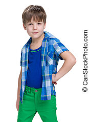 Little boy in a blue shirt on the white background