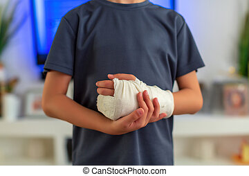 little boy in a cast. child with a broken arm. funny kid after injury