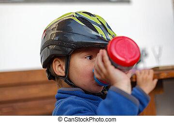 Little boy in a helmet.