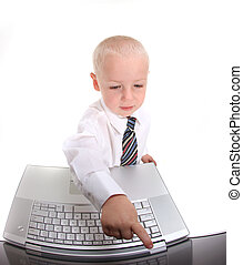 Little Boy in a Suit Working on a Laptop Computer