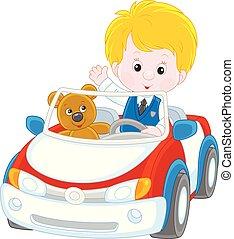 Little boy in a toy car