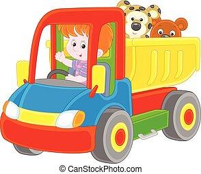 Little boy in a toy truck