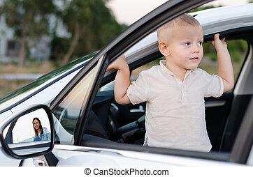 Little boy in an open car door