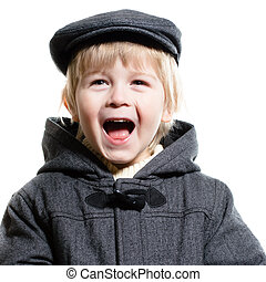 Little boy in autumn coat and hat laughing happy isolated on white background