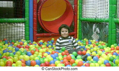Little boy in ball pit