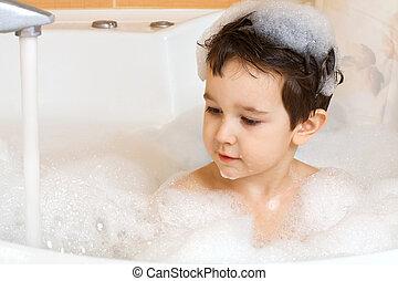 little boy in bath