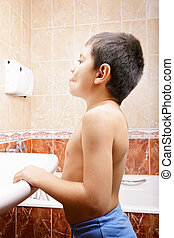 Little boy in bathroom