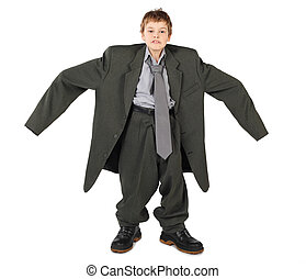 little boy in big grey man's suit and boots nads at sides ...