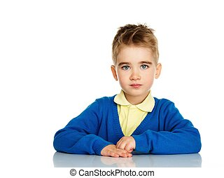 Little boy in blue cardigan and yellow shirt