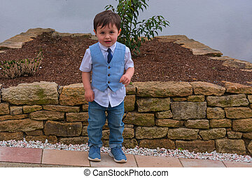 Little boy in blue suit with tie