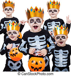 Little boy in costume skeletons.