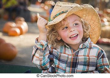Little Boy in Cowboy Hat at Pumpkin Patch