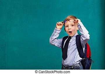 little Boy in eyeglasses with big backpack. School, kid,...