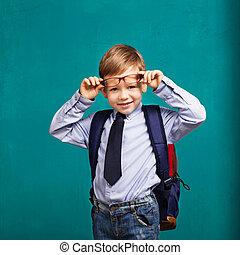 little Boy in eyeglasses with big backpack