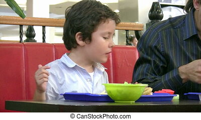 Little boy in fast food restaurant
