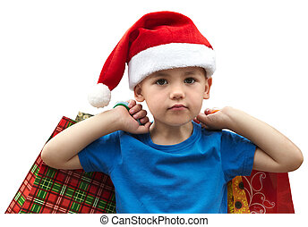 Little boy in fur-cap with shopping bags. Christmas