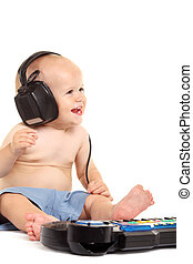 Little boy in headphones on the white