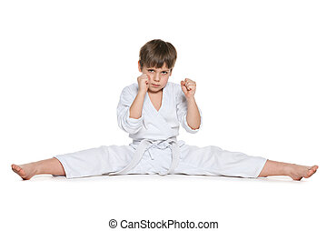 Little boy in kimono against the white