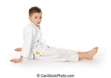 little boy in kimono sitting on a floor