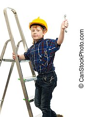 Little boy in protective helmet with wrench tool on a ladder