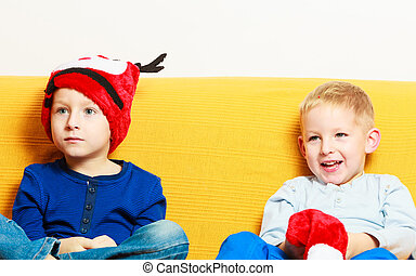 little boy in red winter reindeer hat with his brother