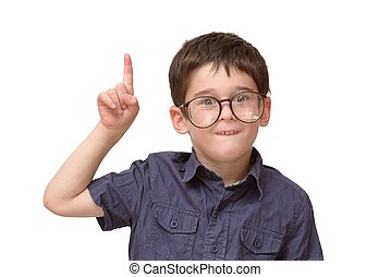 Little boy in round spectacles raising finger in funny attention gesture isolated