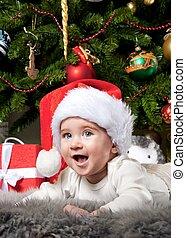 Little boy in Santa Claus hat.