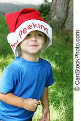 Little boy in Santa hat and blue shirt