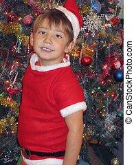 Little boy in Santa outfit