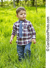 Little boy in shirt and jeans