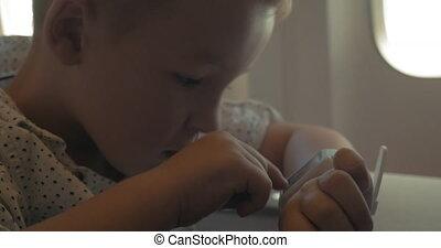 Little Boy in Smart Watch - Little boy is using smart watch...