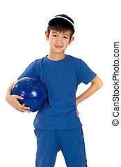 Little boy in soccer uniform with c