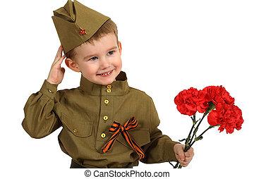 Little boy in Soviet military uniform